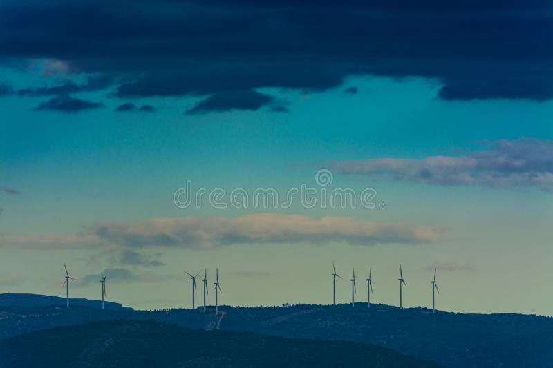 Wind mills in the mountains stock photo