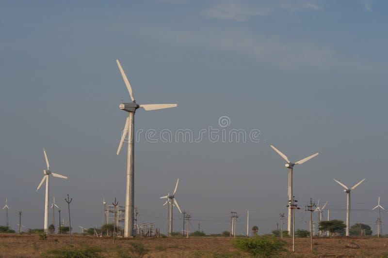 WIND MILLS. Wind turbine in a wind-farm royalty free stock image