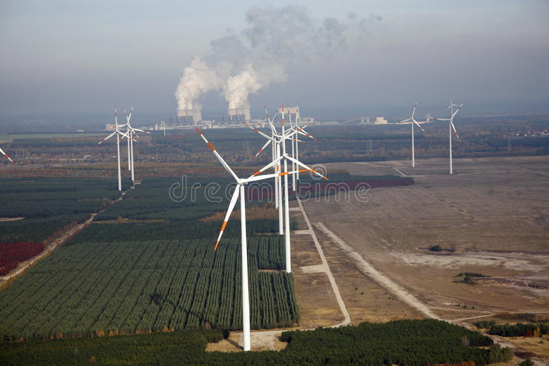 A wind park. A new wind energy park is build up with a coal-fired power plant in the background near Cottbus in Germany stock photo