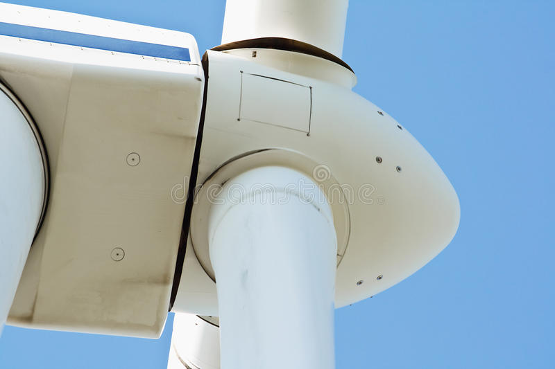Wind power generator close up. Wind turbine used to harness renewable wind power into mechanical energy to generate electricity at wind farms, close up stock image