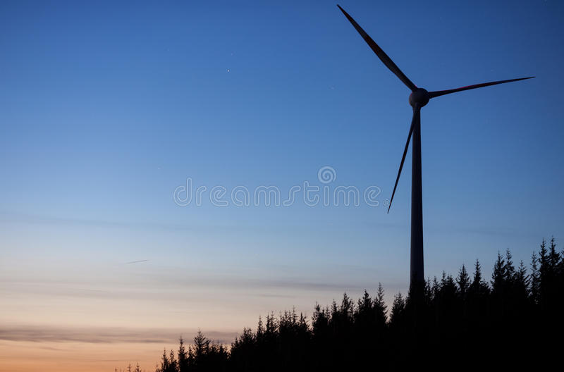 Wind power mill at night stock photography