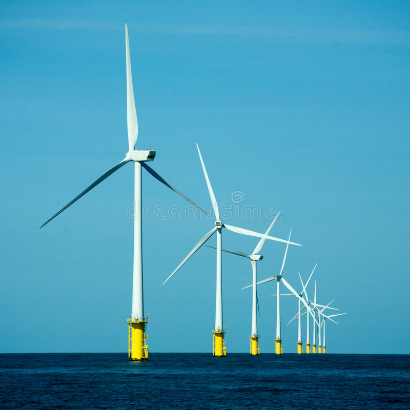 Wind power plant. In a sea royalty free stock photos