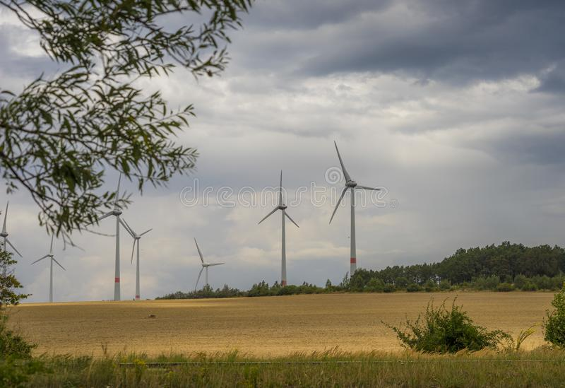 Wind power plant and stormy cloudy heaven stock photo