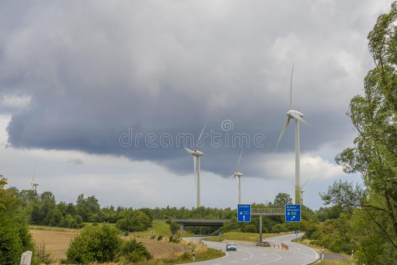 Wind power plant and stormy cloudy heaven stock images