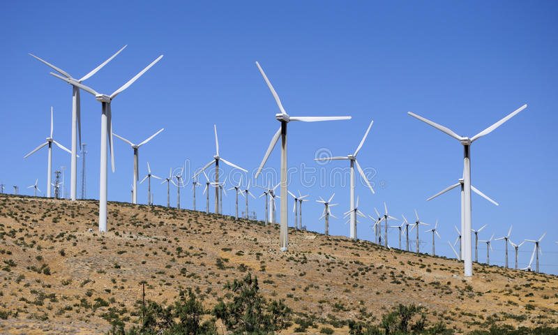 Wind Power. San Gorgonio Pass Wind Farm in Riverside county east of Los Angeles California on a sunny blue sky day generating alternative energy royalty free stock image