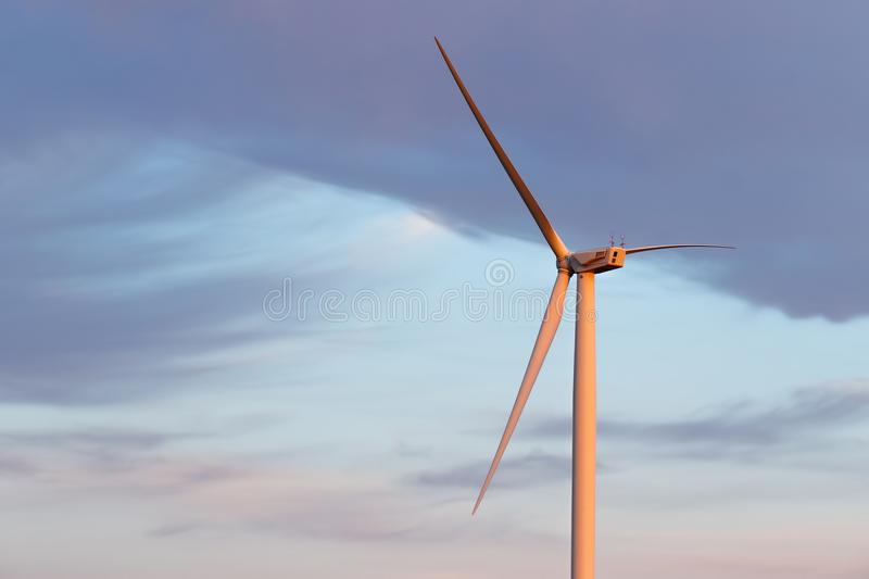 Wind Power Plant Illuminated By The Setting Sun Stock