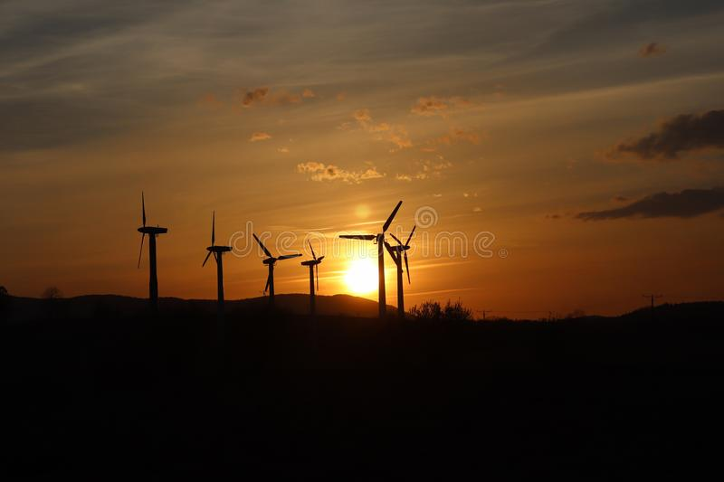 Wind power station in sunset. Romantic evening and modern technologies of ecologically clean electricity. Protection of the enviro. Nment. Bright Future. An royalty free stock images