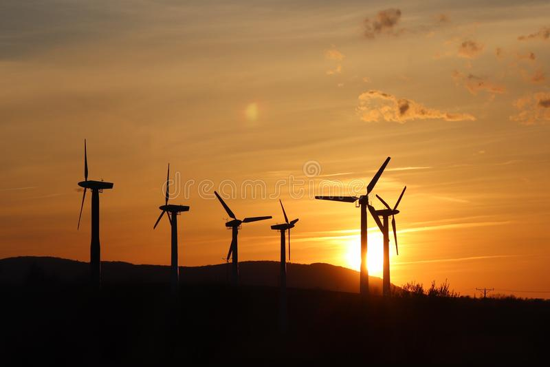 Wind power station in sunset. Romantic evening and modern technologies of ecologically clean electricity. Protection of the enviro. Nment. Bright Future. An royalty free stock photos