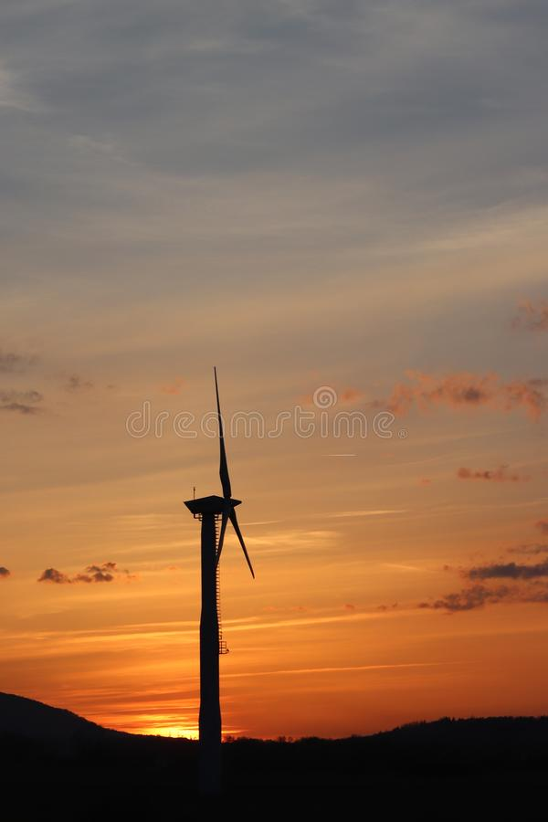 Wind power station in sunset. Romantic evening and modern technologies of ecologically clean electricity. Protection of the enviro. Nment. Bright Future. An stock image