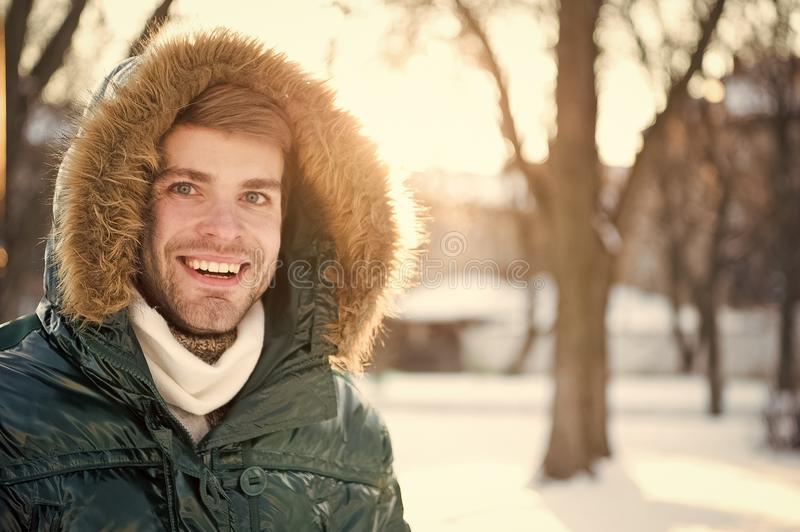 Wind resistant clothes. Winter stylish menswear. Winter outfit. Man bearded stand warm jacket snowy nature background. Hipster winter fashion outfit. Guy wear stock photos