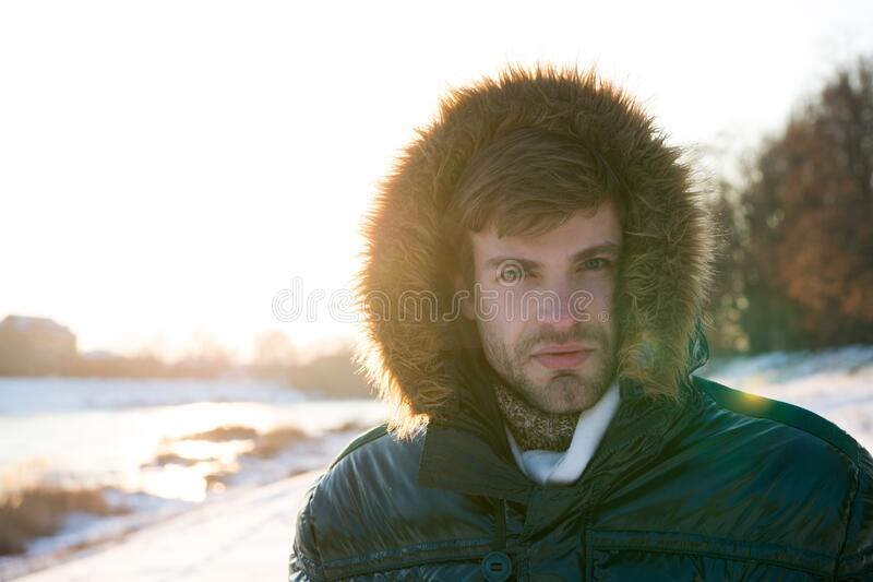 Wind resistant clothes. Winter weather conditions. Polar explorer. Sunny winter day. Winter menswear. Winter outfit stock images