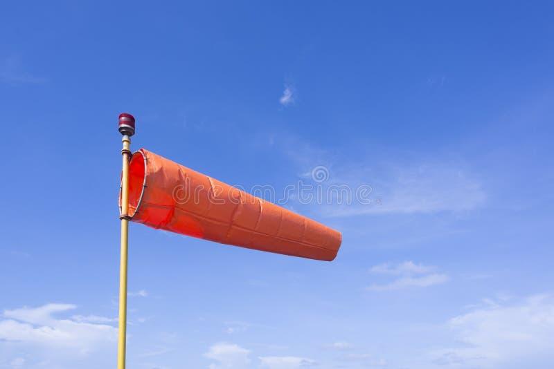 Wind sock in blue sky royalty free stock photo