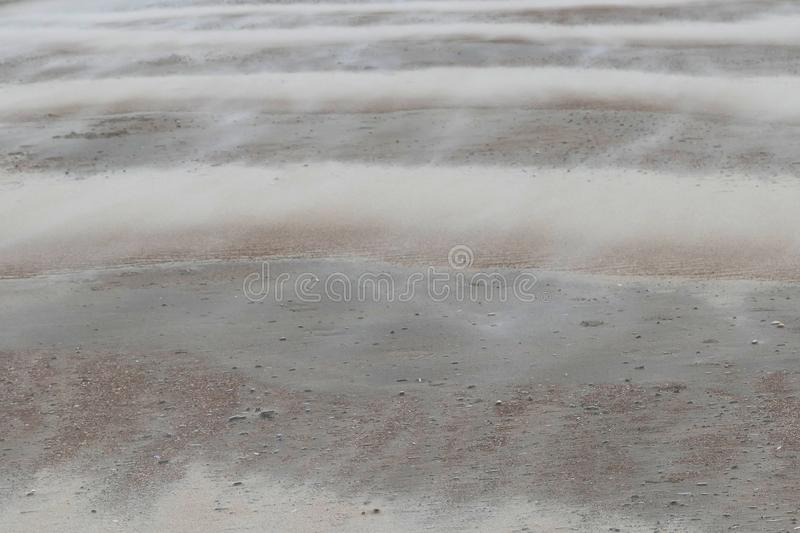 Sand drifts on the striped beach during a hurricane stock images
