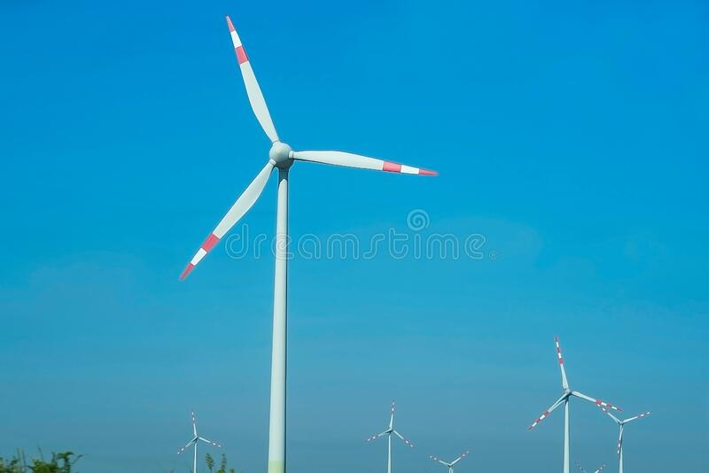 Wind stations, power generation. Farm for the generation of electricity, group modern windmills for renewable electric energy royalty free stock photography