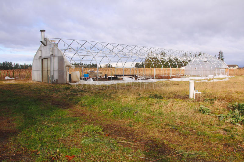 Wind Storm Damage. A greenhouse has suffered extensive damage after a severe wind storm stock photos