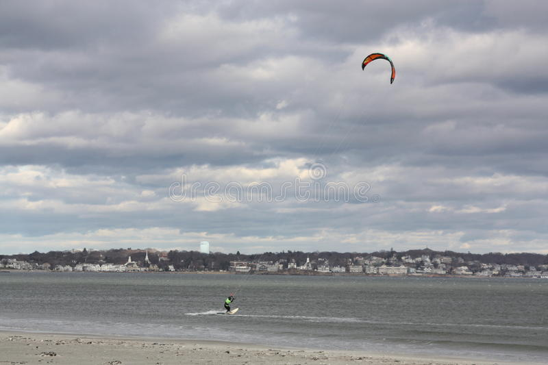 Wind Surfer. The wind was howling at 50 miles per hour off the coast of Nahant Massachusetts and this surfer was catching a great ride stock images