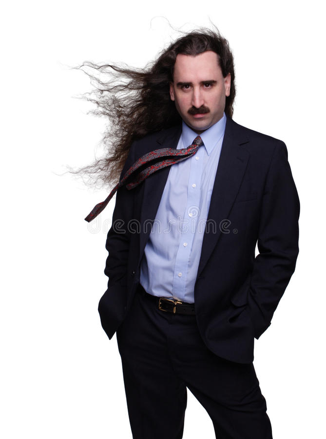 Wind Swept Businessman 1. Fashionable businessman with long hair blowing in the wind stock image