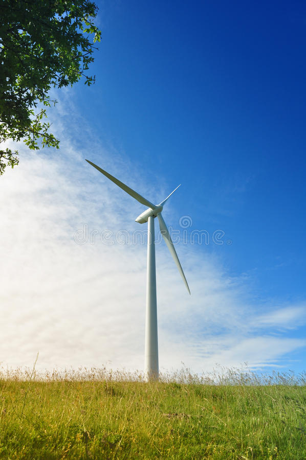 Wind turbine. Under the blue sky: wind energy stock photography
