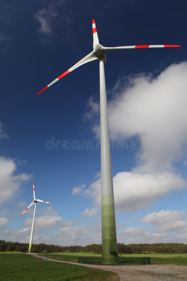 Wind turbine. In a summer field stock image
