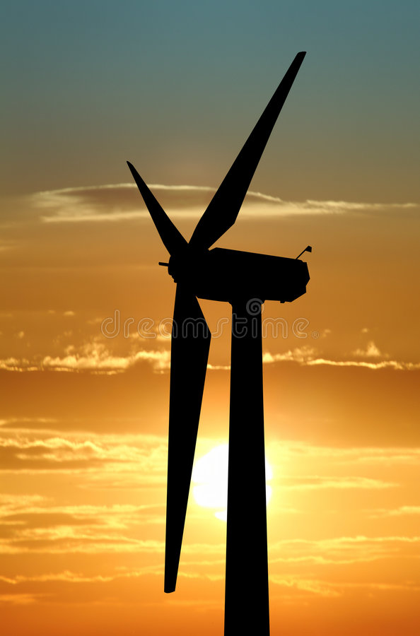 Wind turbine against dramatic sky royalty free stock photo