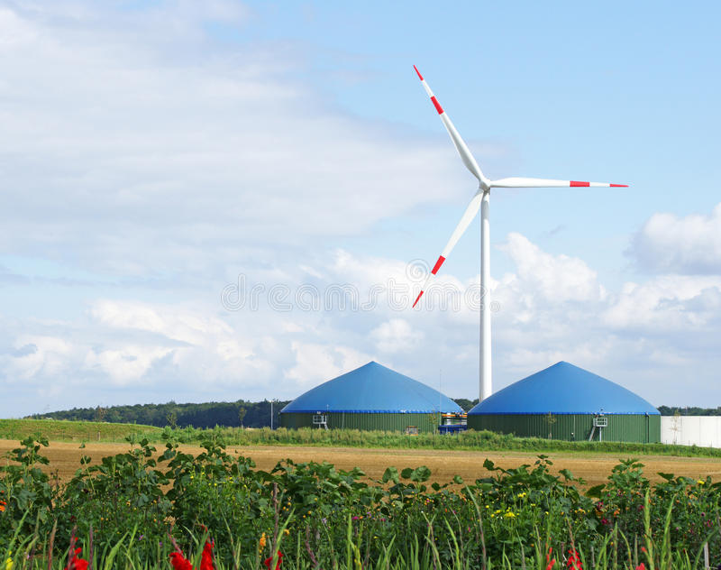Wind turbine and biogas tanks royalty free stock photography