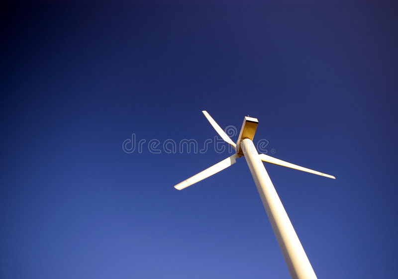 Wind Turbine On Blue. Royalty Free Stock Images