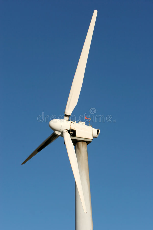 Wind turbine on blue sky - alternative energy royalty free stock images