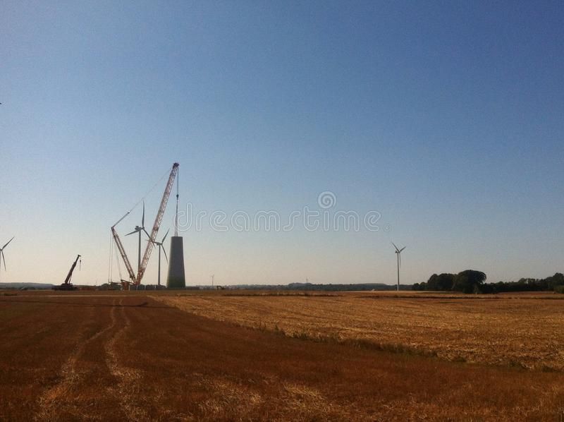 Wind turbine building stock images