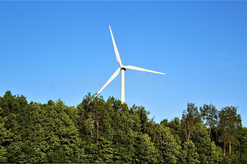 Wind Turbine in Chateaugay, Franklin County, in upstate New York, United States. Wind Turbine in a rural country grass field located in Chateaugay, Franklin royalty free stock photos