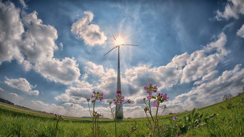Wind turbine in countryside field