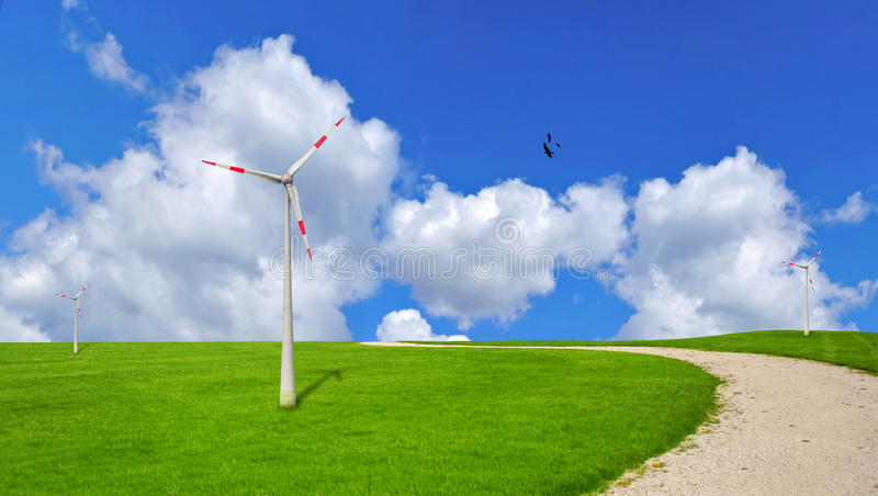 Wind turbine, ecology. Wind turbines on a grass field, ecology problem stock photos