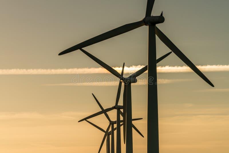 Wind turbine energy generaters on wind farm stock photography