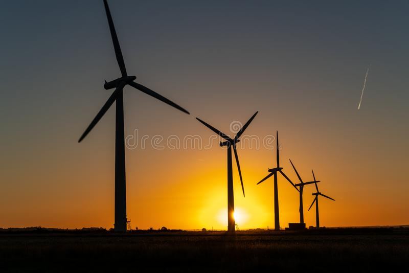Wind turbine energy generaters on wind farm royalty free stock photography