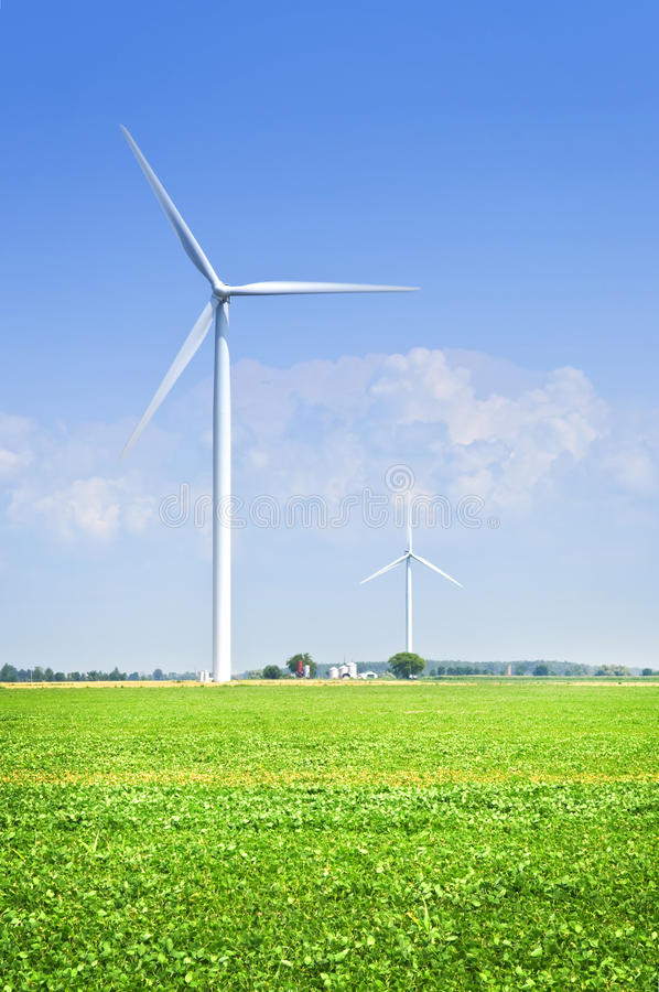 Wind turbine in field. Green alternative clean power wind turbine in field royalty free stock photography