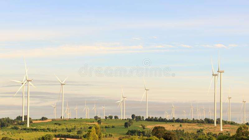 Wind turbine field on the hill for renewable energy source. Landscape background royalty free stock photography