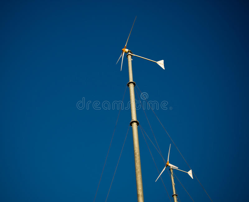 Wind turbine generator. On blue sky royalty free stock images