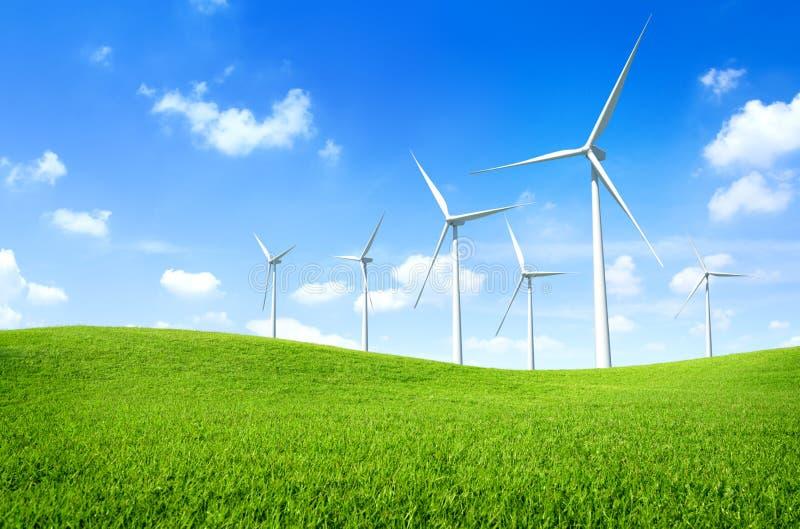 Wind turbine on a green field stock image