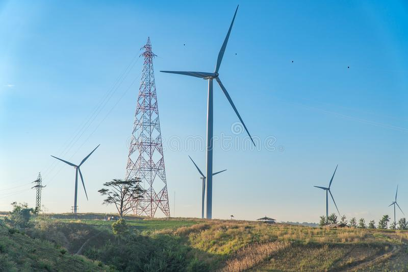 Wind Turbine on Hill, green energy. wind turbine with electric pole on hill royalty free stock images
