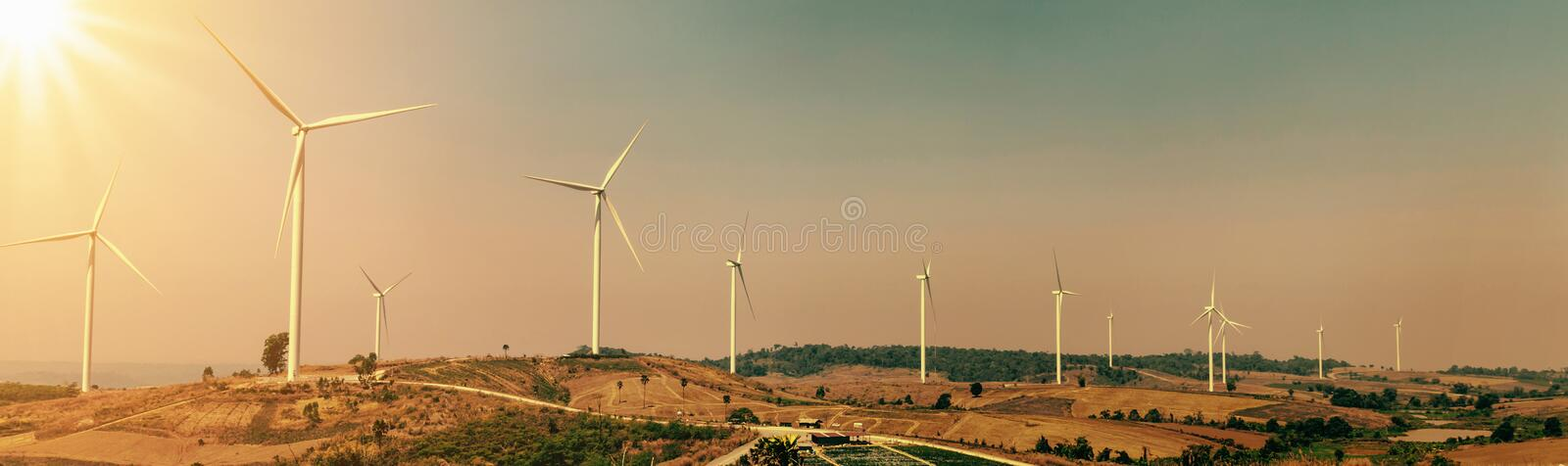 wind turbine on hill with sunlight. concept eco power energy in stock photography