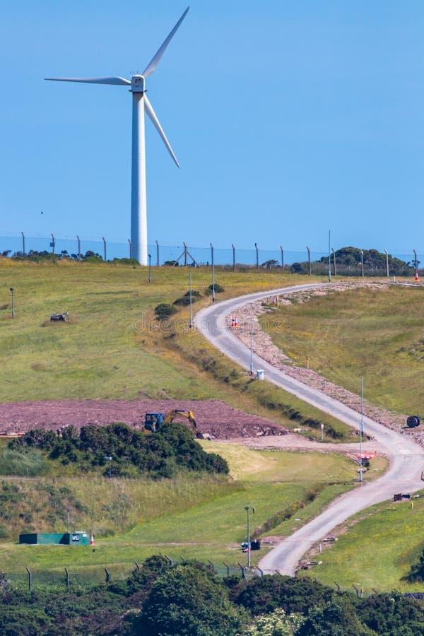 Wind turbine on hill royalty free stock photos