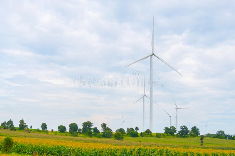Wind turbine made Renewable Energy on field, blue sky and cloud background at Chaiyaphum Thailand. With copy space stock photo