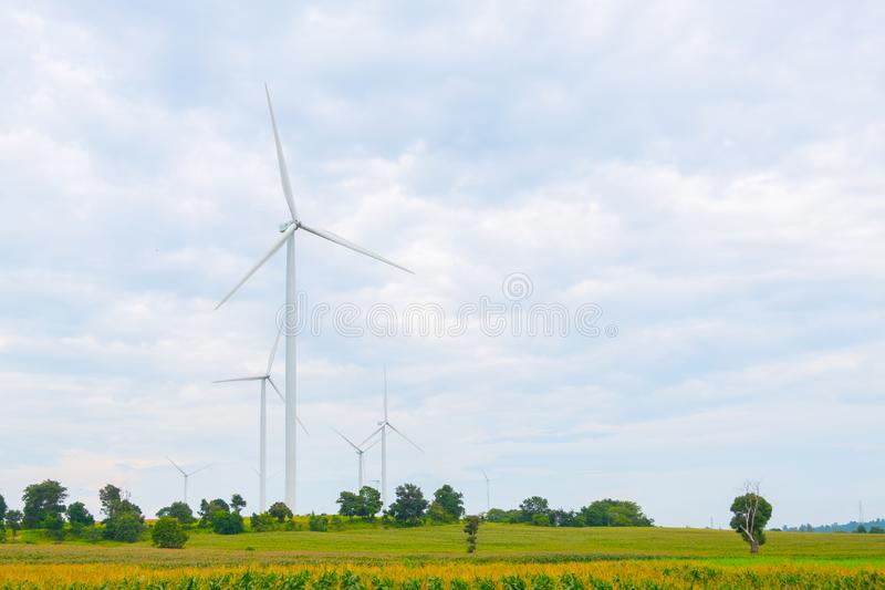 Wind turbine made Renewable Energy on field, blue sky and cloud background at Chaiyaphum Thailand. With copy space royalty free stock photo