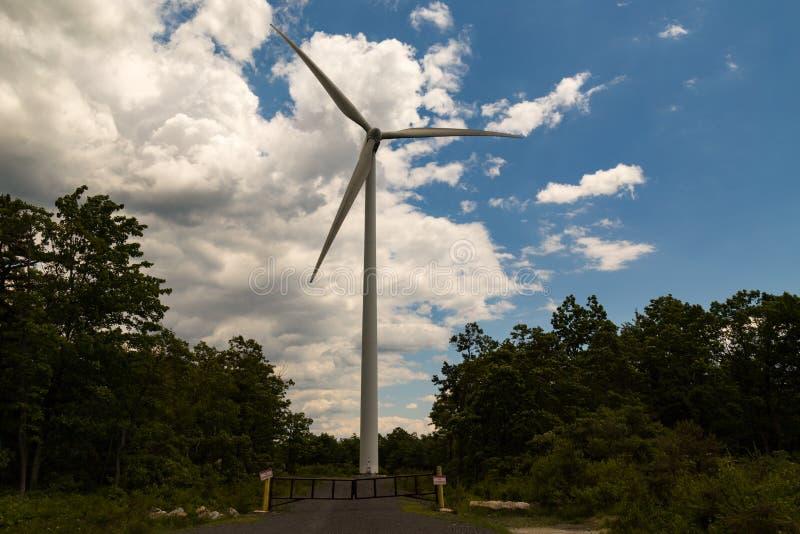 A Wind Turbine. Mahanoy City, PA, USA – June 14, 2016: A Gamesa 2MW wind turbine in operation at the Locust Ridge Wind Farm in Schuylkill County royalty free stock image