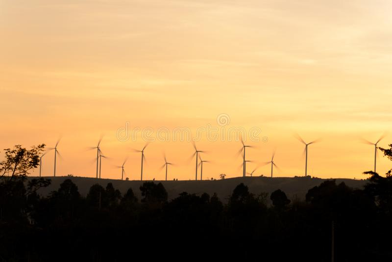 Wind turbine on mountain making electric energy from wind. At evening time royalty free stock image