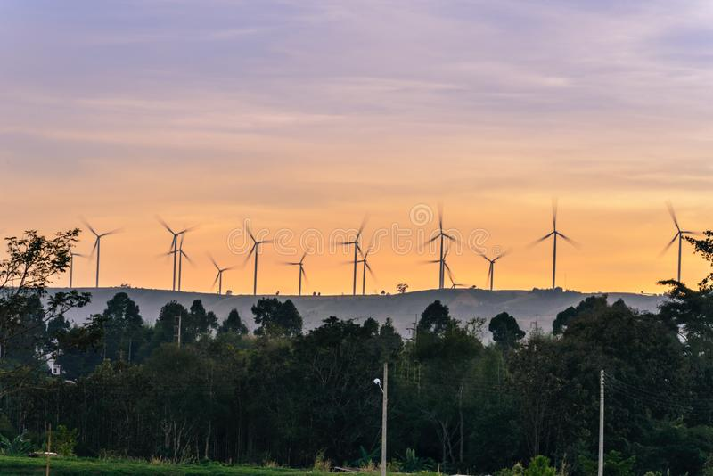 Wind turbine on mountain making electric energy from wind. At evening time stock image