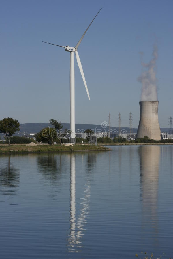 Wind Turbine & nuclear cooling tower stock image
