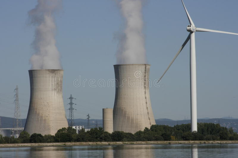 Wind Turbine & nuclear cooling tower stock photos