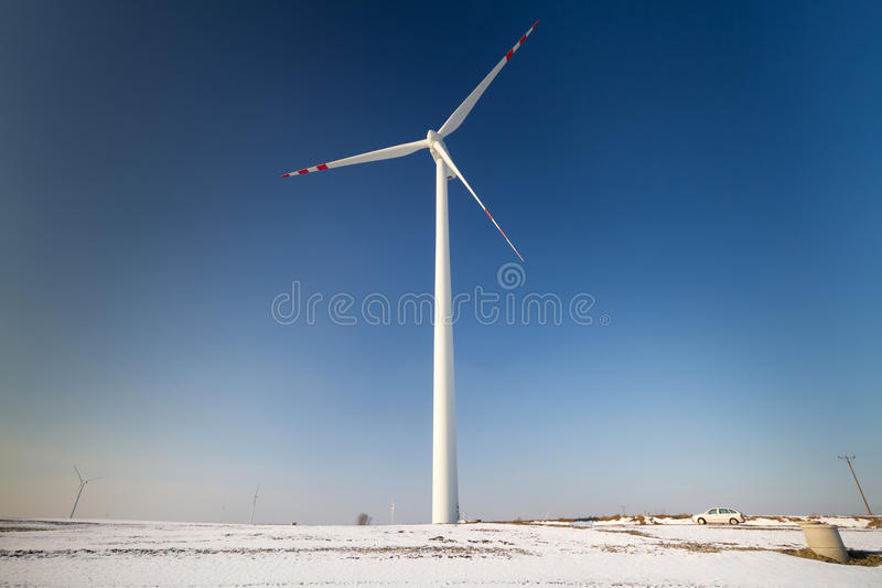 Download Wind turbine over blue sky stock photo. Image of industry - 23535442