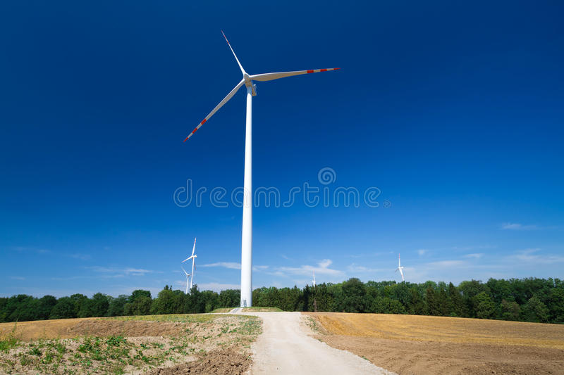 Download Wind turbine over blue sky stock photo. Image of friendly - 26720032