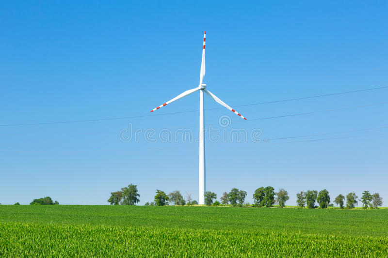 Download Wind turbine over blue sky stock image. Image of field - 31546017